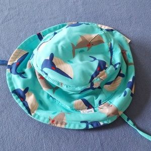 I play baby hat. 0-6months sharks whales
